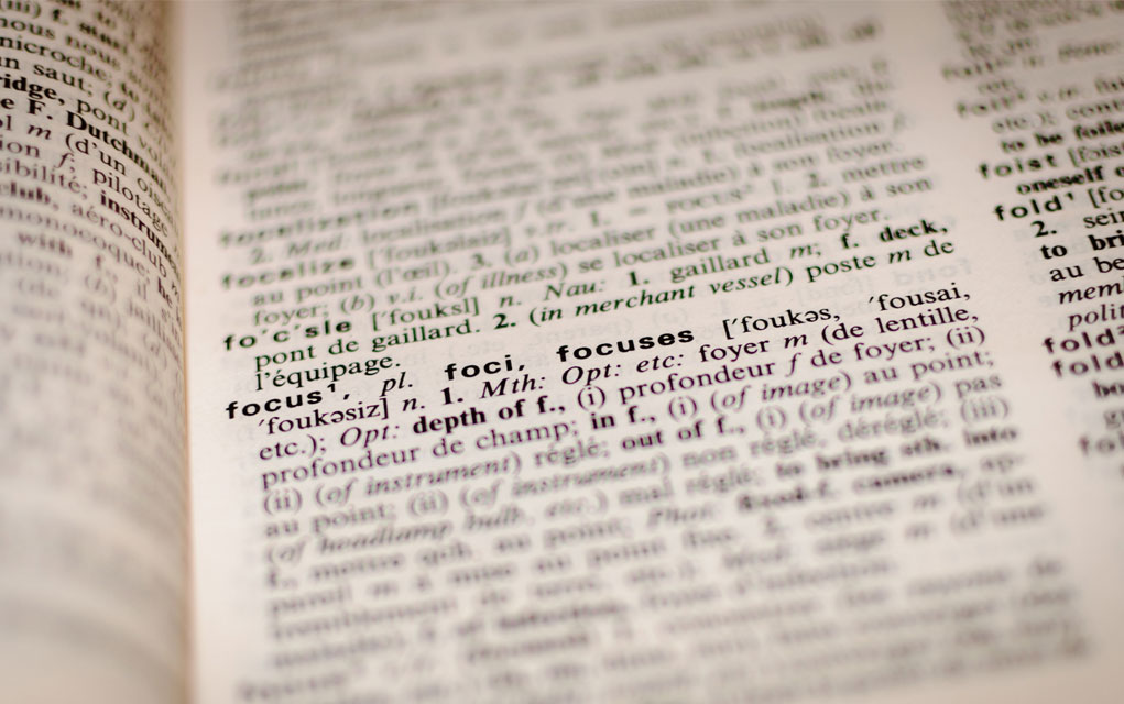 close up of the word defintion in a dictionary