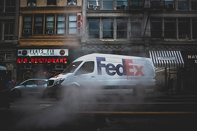 Fed Ex Van with logo and purple and orange brand colors