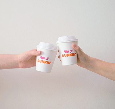 Dunkin Donuts cups with orange and pink brand colors